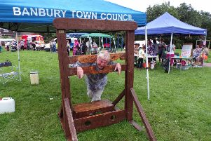 Banbury Summer Fest at Princess Diana Park. Banbury town councillor Barry Richards in the stocks. NNL-170829-093448001
