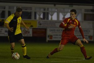 Banbury United's George Nash closes down Chesham United's David Hutton. Photo: Edwin Barson
