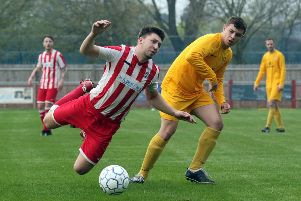 Easington Sports midfielder Charlie Hill goes flying under a challange from Pewsey Vale's Ethan Fishlock
