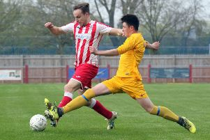 Easington Sports' Michael Spaull takes on Pewsey Vale's Harvey Tooth during Saturday's clash at Addison Road