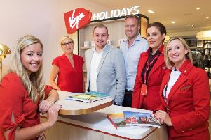 Staff at the Virgin Holidays concession in Next are ready for the opening on Friday. Photo: Virgin Holidays