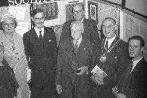 Members of the Banbury Historical Society at an exhibition in the Town Hall with Mayor and Mayoress, Councillor Malcolm Spokes and Mrs Spokes (1957-58). Founder member Jeremy Gibson extreme right and President Lord Saye and Sele centre