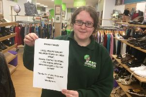 Ella Harriss of Wood Green charity shop in Banbury's High Street is looking for the owner of a lost canary  NNL-180920-153238001