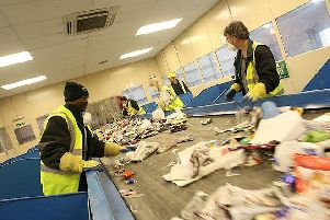 Workers manually sorted waste at a materials recycling facility