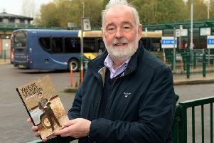 Mervyn Edwards, a former Banbury man, with his book about being a Thames Valley Police firearms officer. NNL-180611-131640009