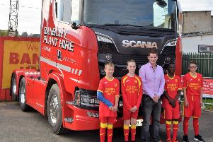 Banbury Plant Hire Director Nathan Matthews with some of the Banbury United youth players in their new shirts