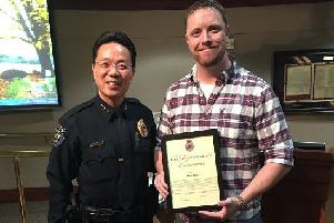 Mitch Mellott (right) being presented with his Chief Superintendent's Commendation by Federal Way's Chief of Police Andy Hwang
