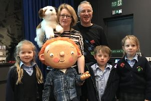 Authors Adam and Charlotte Guillain with George visit Sibforb School NNL-181119-150832001