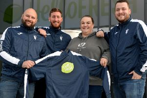 Hello Fresh, Banbury, present new tops to Hardwick Sports FC. From the left, Danny Cockle, James Trevitt, Sally Harper-Burns, Hello Fresh and Kyle Field. NNL-181117-185832009