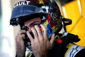 Carlos Sainz takes his helmet off for the final time for the Renault Sports F1 Team after Sunday's Abu Dhabi Grand Prix