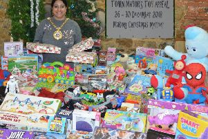 Banbury mayor Shaida Hussain with just some of the donated toys for the town's Christmas toy appeal. NNL-180412-155358001