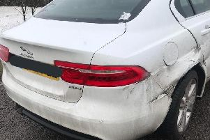 A Jaguar was damaged after crashing into the barrier on the M40 during the snow. Photo: Warwickshire Police