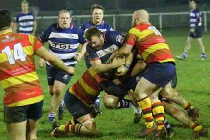 Banbury Bulls' Nick Pratt is held up during Friday's semi-final with Bicester. Photo: Simon Grieve