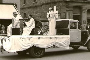 The Workpeople's Association float in the 1937 Hospital Carnival Fete procession Faith, Hope and Charity NNL-190225-113305001