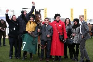 Trainer Ben Case and jockey Kielan Woods with Croco Bay and his winning connections at the Cheltenham Festival