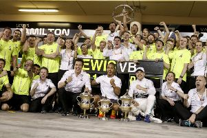 Lewis Hamilton and Valtteri Bottas celebrate with the rest of the Mercedes AMG Petronas team after Sunday's Bahrain Grand success. Photo: Wolfgang Wilhelm