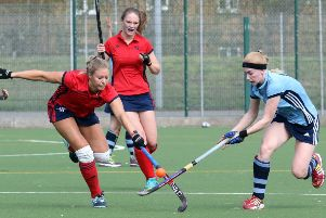 Banbury's Natasha Roberts and High Wycombe's Milly Lloyd-Hunt battle for possession. Photo: Steve Prouse