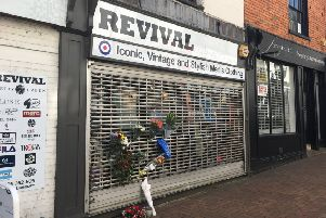 Flowers were laid outside Revival menswear on Parsons Street after the death of shop owner Nik Hale NNL-190304-100234001