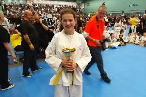 Gold winning student Charlotte Carter with trophy NNL-190404-090014002