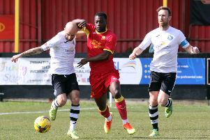 Banbury United's Greg Kaziboni is closed down by King's Lynn Town's Chris Henderson and Ryan Jarvis. Photo: Steve Prouse