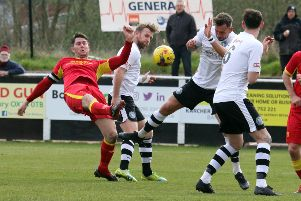 Banbury United's Ricky Johnson is crowded out against King's Lynn Town. Photo: Steve Prouse
