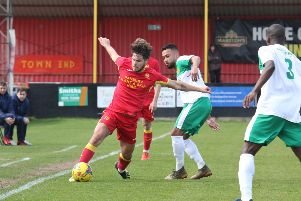 Giorgio Rasulo keeps the ball in play during Banbury United's defeat against Hitchin Town. Photo: Steve Prouse NNL-190427-174335002