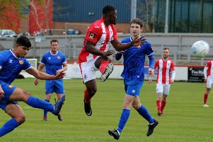 Top scorer Lee Ndlovu is thwarted during Brackley Town's game against FC United of Manchester. Photo: Jake McNulty