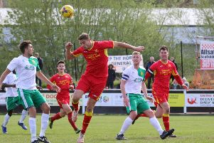 Banbury United's Charlie Wise wins a header against Hitchin Town. Photo: Steve Prouse