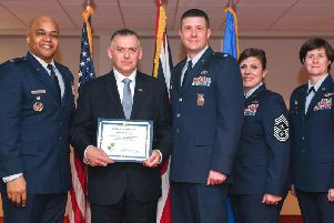 Gary Crook is presented with his honorary commader certificate by (L-R) US Air Force Col Ron Cheatham, Lt Col Ray Elmore, Chief Master Sgt Lori Gawan and Col Bridget McNamara. Photo by Senior Airman Chase Sousa.
