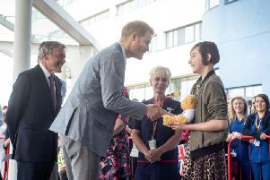 The Duke of Sussex outside Oxford Children's Hospital with Daisy Wingrove. Photo: OUH