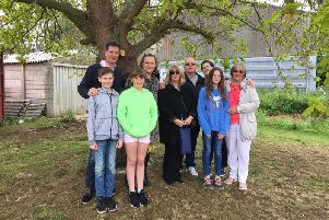 Chris Hughes' family after the scattering of the ashes on Saturday at Chipping Warden cricket ground NNL-190521-101613001