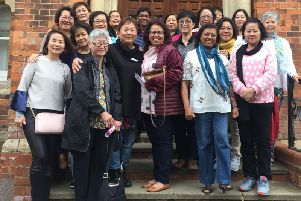 The Malaysian nurses outside the Horton General Hospital where they trained more than 40 years ago. Photo: OUH
