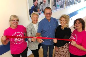 Dayle Kinchs daughters Leah Kinch and Danielle Grant with widower Steve Kinch, Sarah Vaccari and Gail Williams from Horton General Hospital Charity cutting the ribbon on the new photography exhibition. Photo courtesy of the charity