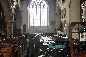 The community has come together to help protect The Church of St Peter and St Paul's interior while the roof is repaired. Photo supplied by the church