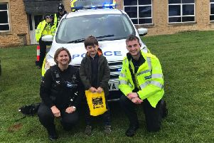 Louie with officers from Brackley at the carnival. Photo: Northamptonshire Police