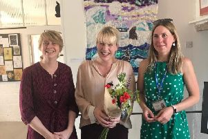 Artist Nancy Cadogan with staff from Culworth Primary Academy at the exhibition launch at Forge Coffee NNL-190626-101035001