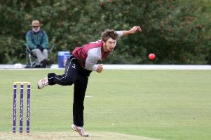 Banbury bowler Charlie Hill sends down a delivery against Buckingham Town at White Post Road. Photo: Steve Prouse