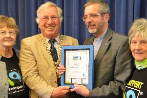 Mayor John Colegrave receives the certificate from Rev Eddy with Fairtrade'committee members Peggy Myer (left) and Enid Frost