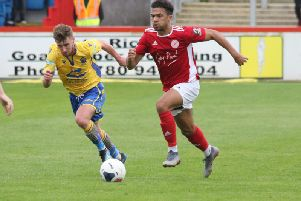 Brackley Town's Luke Fairlamb goes on the attack against Warrington Town. Photo: Steve Prouse