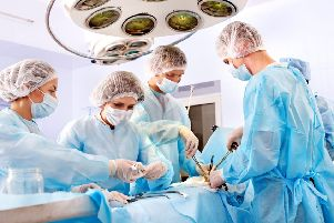 Team surgeon at work in operating room. PPP-141119-162832001