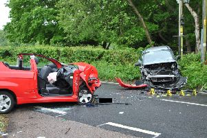 Two cars crashed head-on on the A21. Photo by Dan Jessup