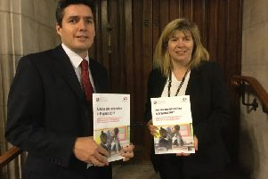 Maria Caulfield MP and Huw Merriman MP in Parliament with a copy of the published report SUS-170712-125501001
