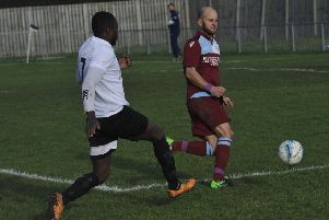 Little Common player-manager Russell Eldridge blocks the path of Bexhill United wide player Georges Gouet. Pictures by Simon Newstead