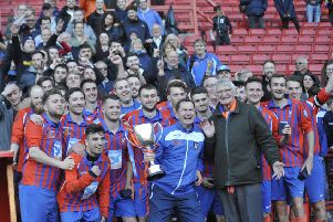 Battle Baptists celebrate with their supporters after winning the National Christian Cup at The Valley in May. Picture by Simon Newstead