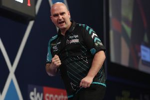 Rob Cross celebrates an important dart against John Henderson. Picture courtesy Lawrence Lustig/PDC