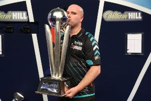 Rob Cross kisses the trophy after winning the 2018 William Hill World Darts Championship. Picture courtesy Lawrence Lustig/PDC