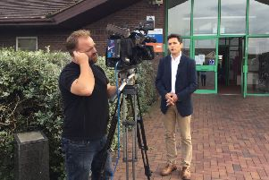 Huw Merriman MP being filmed by the BBC at one of his Brexit talks SUS-180830-124257001