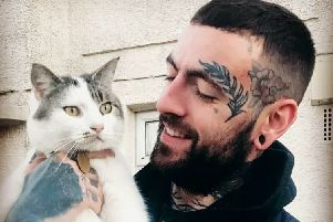 Rudi Ridgewell with Bruno, a cat that gets up to all sorts of scrapes in Worthing