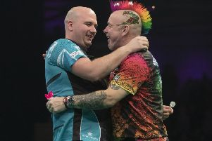Rob Cross (left) and Peter Wright are all smiles after their 6-6 draw in Newcastle. Picture courtesy Lawrence Lustig/PDC