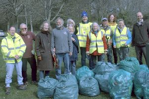 Bexhill Lions joined members of the Bexhill Environmental Group for a litter pick on the Downs. SUS-190904-113116001